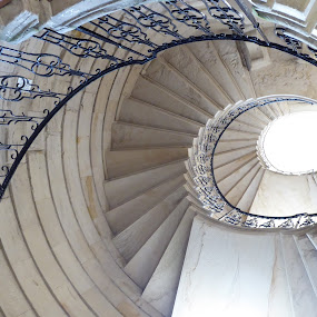 Looking up by Vicki Clemerson - Buildings & Architecture Public & Historical ( light, railing, stairs, spiral, lookingup, up, steps, staircase )