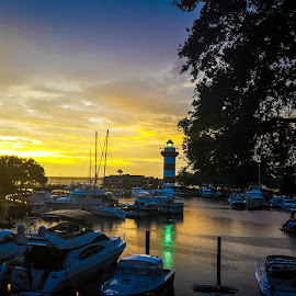Hilton Head Sunset by Tim Waters - Landscapes Waterscapes ( water, sunset, boats, lighthouse, marina,  )