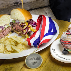 Bluesiana Burger with Zydeco Sauce, Root Beer Glaze and Mardi Gras Slaw