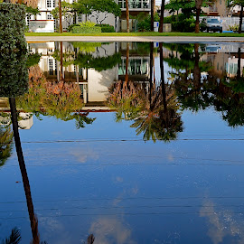 After the Storm by Robert Ratcliffe - City,  Street & Park  Street Scenes ( water, reflection, blue sky, florida, street, street scene, storm, rain,  )