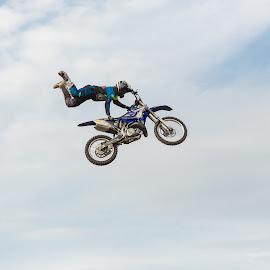 by Radosław Jankowski - Sports & Fitness Motorsports ( flying, sky, bike, superman, adrenaline, fly, tricks, motor, motorcross, motorcycle, show, xtreme )