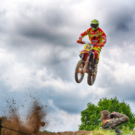 Explosion ! by Marco Bertamé - Sports & Fitness Motorsports ( clouds, orange, speed, green, number, yellow, 14, race, noise, jump, flying, motocross, cloudy )