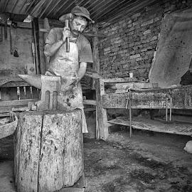The Horseshoemaker by Marco Bertamé - Black & White Portraits & People