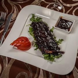 Ribs by Ewald Gruescu - Food & Drink Plated Food ( gruescu, nikon, sigma, ewald, barbecue, foodporn, restaurant, plate, sauce, ribs, photography, food )