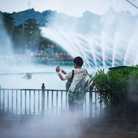 Wet photographer by Tony Mortyr - City,  Street & Park  Amusement Parks ( fontain, amusement park, china )