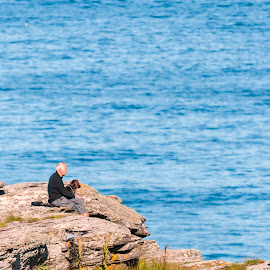 Afternoon by John P Carr - Landscapes Caves & Formations ( calm, seashore, exteriors, cliff, sea, dog, people, coast, man, relax, tranquil, relaxing, tranquility )