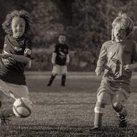 Running for the Ball - B&W by Garry Dosa - Black & White Sports ( teams, ball, toned sepia, boys, action, sports, children, game, running, soccer )