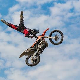by Radosław Jankowski - Sports & Fitness Motorsports ( clouds, flying, sky, motocross, motorbike, tricks, fly, show, superman., cross )