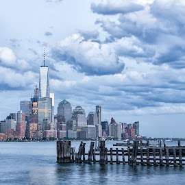 Manhattan Skyline at Dusk by Carol Ward - City,  Street & Park  Skylines ( clouds, manhattan skyline, pier a park, pier, manhattan, hoboken, freedom tower, dusk, hudson river )