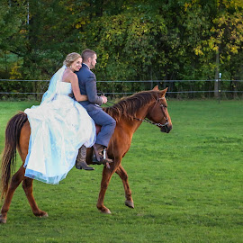 Riding Off Into Their Future by Kathy Suttles - Wedding Bride & Groom