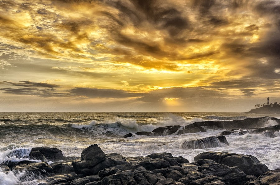 by Neelakantan Iyer - Landscapes Sunsets & Sunrises ( clouds, beaches, vizhinjam, sunset, lighthouse, trivandrum, india, kerala )