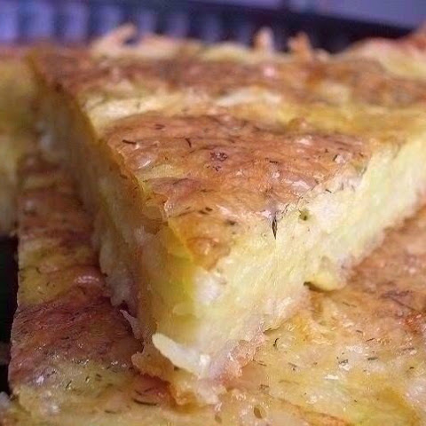 Casserole Of Grated Potatoes With Cheese And Garlic