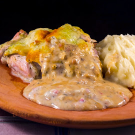 Chicken casserole with sheep cheese by Lajos E - Food & Drink Meats & Cheeses ( chicken, breast, dish, sheep cheese, platter, casserole, wooden, puree, meat, plate, dill, potato, table, meal )