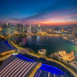 The City of Singapore by Binoy Uthup - City,  Street & Park  Skylines ( cityscapes, urban landscapes, hdr, nightshot, night lights, mbs skypark view, blue hour, sands skypark view, cityscape, hdr photography, singapore, nightscape, city, night shots, urban, night view, blue, sunset, night, night sky, 56thfloor )