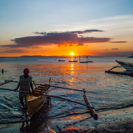 Docking the Boat by Ynon Francisco - Transportation Boats ( work, fish, sea, living, batangas, boating, sky, banca, lemery, sunset, fishing, fisherman, golden hour )
