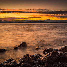 Sunset on the Sound by Brad Larsen - Landscapes Sunsets & Sunrises ( water, sunset, beach, rocks, slow shutter )