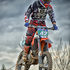 Speed Jump by Marco Bertamé - Sports & Fitness Motorsports ( red, wheel, motocross, 42, speed, green, cloudy, brown, number, race, noise, jump )