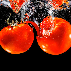two tomato in the water by Markus Gann - Food & Drink Fruits & Vegetables ( raw, reflection, smooth, tomato, splash, underwater, drop, beauty, pot, close, clear, clean, nature, fresh, glass, wet, bunch, transparent, motion, medicine, black, closeup, water, cool, worn, flowing, bubbles, bubble, nutrition, liquid, red, pattern, food, background, healthy, ripple, freshness, flare, group, vegetable, natural )