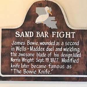 James Bowie, wounded as a second in Well-Maddox duel and wielding, the awesome blade of his design, killed Norris Wright Sept. 19, 1827. Modified knife later became famous as