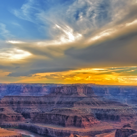 Canyon Sunset by Michael Buffington - Landscapes Sunsets & Sunrises ( clouds, orange, desert, colorful, canyon, yellow, sky, environment, red, magenta, nature, color, blue, sunset, state park, formations, brown, deadhorse canyon, natural, rocks, river )