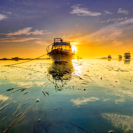 Sneaking Behind by Choky Ochtavian Watulingas - Transportation Boats ( clouds, seaweeds, boats, reflections, seascape, sunrise, boat, skies )