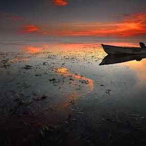 floating boat by Dody Herawan - Landscapes Sunsets & Sunrises