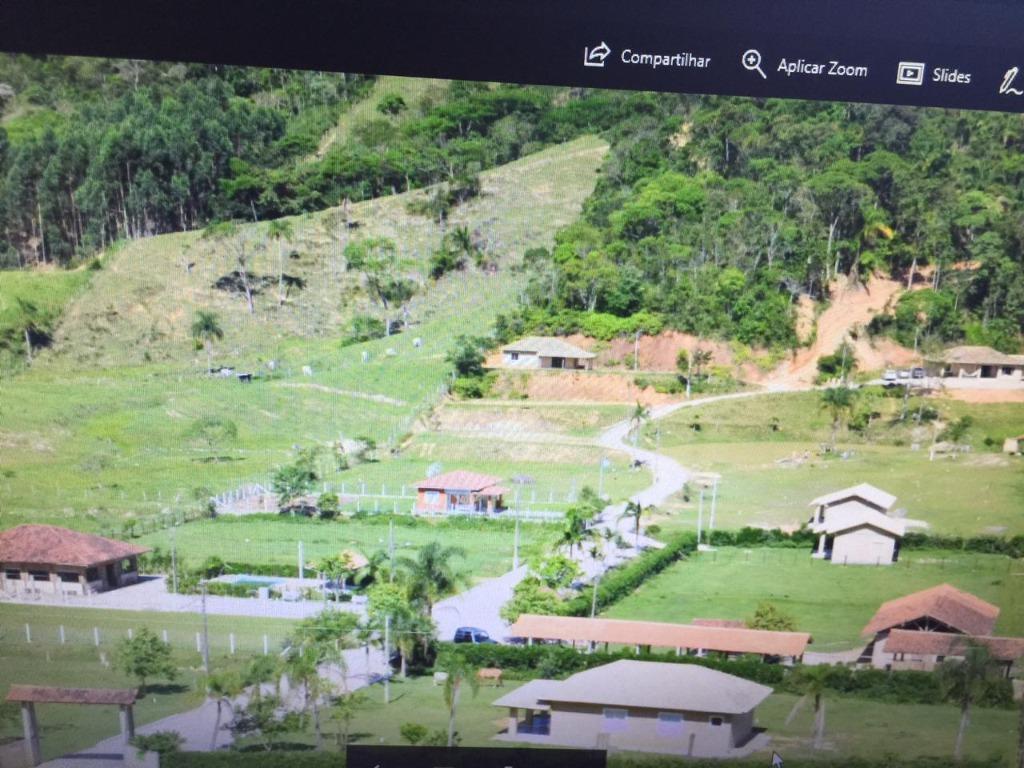 Terreno em condomínio venda, 656 m² por R$ 150.000 - Timbé - Tijucas/SC