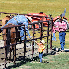 Little Helper by Alexandria Shankweiler - Sports & Fitness Rodeo/Bull Riding ( child, rope, horse, rodeo, children, son, boy, hat, father )