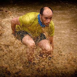 Muddy Bath by Marco Bertamé - Sports & Fitness Other Sports ( water, splatter, differdange, splash, 2015, yellow, soup, luxembourg, muddy, strong, brown, strongmanrun, man )