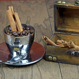 Cinnamon box and coffee in a steel cup. by Dipali S - Artistic Objects Still Life ( cup, stick, aroma, aromatic, spice, spoon, beauty, sack, ingredient, closeup, dessert, wooden box, isolated, dry, cinnamon, bean, decoration, saucer, coffee, white, flavor, steel, close-up, herb, food, background, sticks, brown, natural, napkin )