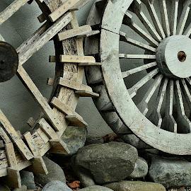 wooden wheels by Prasanta Das - Artistic Objects Still Life ( wooden wheels, steel life, stones )