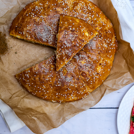 Round bread by Yancho Zapryanov - Food & Drink Cooking & Baking ( pesto, seed, gourmet, whole, preparation, tomatoes, white, flour, loaf, wheat, grain, diet, organic, macro, bread, fiber, oat, bakery, homemade, natural, oven, nature, brown, delicious, vitamin, food, crust, meal, traditional, cereal, closeup, healthy, bake, sesame, tasty, breakfast, fresh, crop, rye )