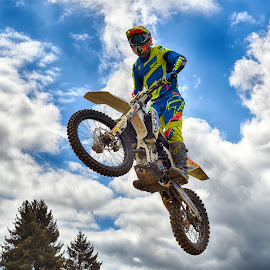 Uprightly In The Air ! by Marco Bertamé - Sports & Fitness Motorsports ( clouds, wheel, speed, uprightly, yellow, race, noise, jump, flying, motocross, blue, cloudy, air, grey, high )