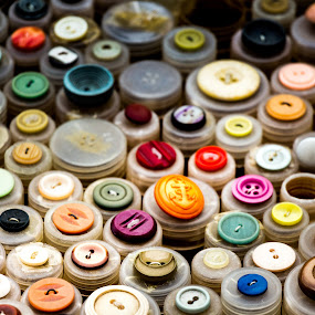 Collection of colorful buttons. by Roger Hamblok - Artistic Objects Other Objects ( rounds, round, yellow, circle, anchor, sewing suppliels, circles, button, dressmaking, pile, grey, holes, black, orange, purple, green, collecition, white, buttons, accumulation, red, market, pattern, blue, fuchsia, needle, brown, stack,  )
