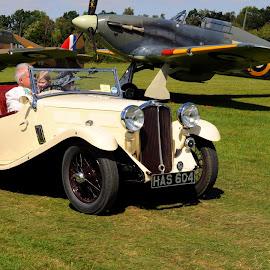 Triumph Gloria by DJ Cockburn - Transportation Automobiles ( piston engine, automobile, sports car, hawker hurricane mk 1, rolls-royce merlin, triumph gloria, shuttleworth collection, england, 605 squadron, fleet air arm, royal air force, airfield, battle of britain, royal navy, tourer, propeller, vintage, airplane, aeroplane, z7015, open top, biggleswade, museum, has604, 880 squadron, r4118, hawker sea hurricane mk 1b, aircraft, old warden, bedfordshire, air display, raf, antique, britain, air show )