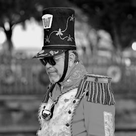 It's Beggining To Look A Lot Like Christmas by Jarrod Unruh - Public Holidays Christmas ( holidays, celebrations, men, costume play, man, black and white, holiday, christmas, costume )