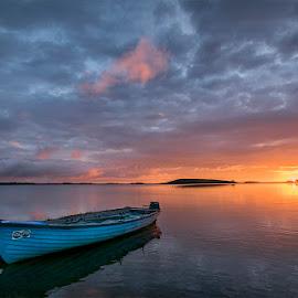 Sunrise at Lough Corrib by Wojciech  Golebiewski - Transportation Boats ( sunrise, color, natural, golden hour, natural light, clouds, summer, boat, landscape )
