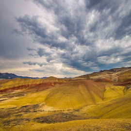 Painted Hills Oregon by Gary Piazza - Landscapes Mountains & Hills ( clouds, oregon, mountains, red, color, fossil beds, valley, yellow, landscapes, soil, painted hills )