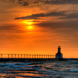 Sunset on the Beach by John Larson - Landscapes Sunsets & Sunrises ( clouds, water, sky, sunset, lighthouse, lake, cityscape )