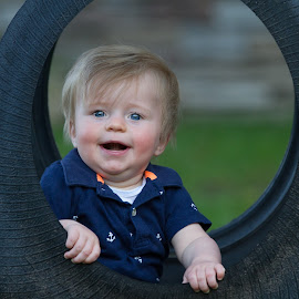 Archer In Tire Swing by Craig Lybbert - Babies & Children Toddlers ( tire swing, blonde, happy, swing, toddler, boy )