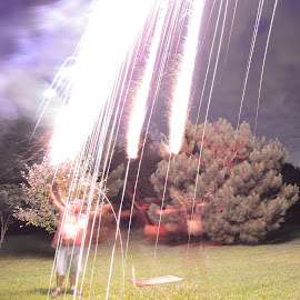 Sparks Falling by Thomas Shaw - Abstract Fire & Fireworks ( clouds, chair, sky, roman candle, grass, trees, fireworks, me, backyard, sparks, man, smoke, fire, works,  )