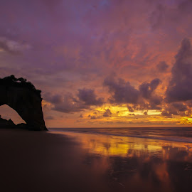Tusan Horse Drinking Water Shaped Cliff  by Aaron Sim - Landscapes Sunsets & Sunrises ( cliffs, sarawak, rocks, reflections, sunset, silhouette, icon, sunsets, malaysia, silhouettes, borneo )