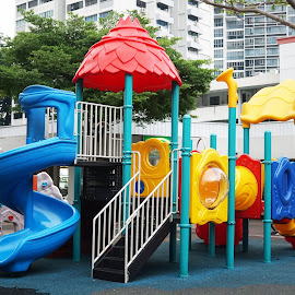 Playground by Alice Chia - City,  Street & Park  Neighborhoods ( roof, playground, stairs, red, colourful, blue, children, yellow, laddles )