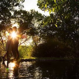 Sunflare by Kylie Nielson Howes - People Couples ( water, reflection, sunset, engagements, flare, photography, sun, couples )
