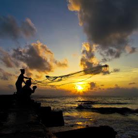 Throw for the life..! by Karthikeyan Chinnathamby - People Street & Candids ( canon, sun rise, talakuppam, sea, south india, people, sun, sx30, cloud, karthikeyan, india, fisherman, man )