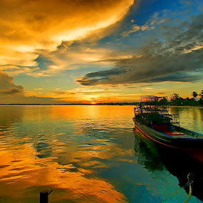 Alone in the sunrise by Sigit Setiawan - Landscapes Sunsets & Sunrises ( claudy, indonesia, tanjung tinggi, beach, sunrise, boat )
