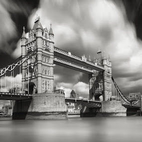 Tower Bridge in London by Pete Barnes - Buildings & Architecture Bridges & Suspended Structures ( monochrome, black and white, fine art, cityscape, landscape, photography, city, st pauls, thames, london bridge, tower bridge, dramatic, dark, photographer, pete barnes, long exposure, building, art, professional, urban, tower, london, contemporary, outdoors, moody, cloud, landscape photography, scene, cathedral, view, bridge, mono, battersea power station )