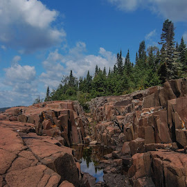 On the Rocks by Robert Coffey - Landscapes Mountains & Hills ( water, clouds, hillside, minnesota, trees, forest, rocks )