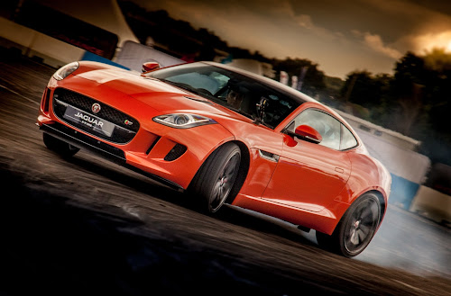Sideways by John Walton - Transportation Automobiles ( skid, jaguar, orange, heritagefocus, jag, f type )