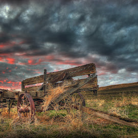 Hay Cart in Sunset by Eric Demattos - Landscapes Sunsets & Sunrises ( red clouds, sunset, eric demattos, cart, storm, antique )